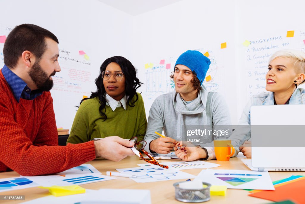 International Group Of Friends Developing Startup Ideas In Office