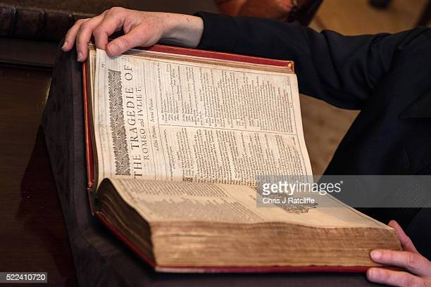 International Head of Books and Manuscripts Margaret Ford handles the first folio of William Shakespeare's work that contains the play 'Romeo and...