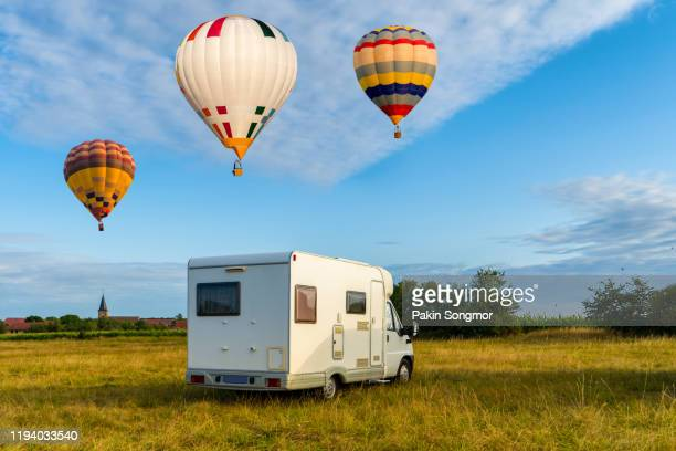 international hot air balloons festival and motorhomes parked at lorraine mondial - camper van stock pictures, royalty-free photos & images