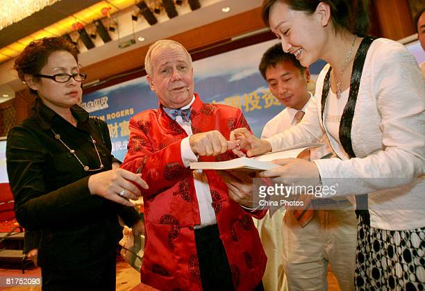 International investor Jim Rogers signs autograph for a Chinese woman at a fortune forum held by a Chinese bank and a local newspaper on June 28 2008...