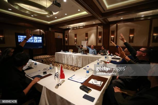 International jury members gather to evaluate the applicants' photographs for the 2018 Istanbul Photo Awards in Istanbul Turkey on March 18 2018...