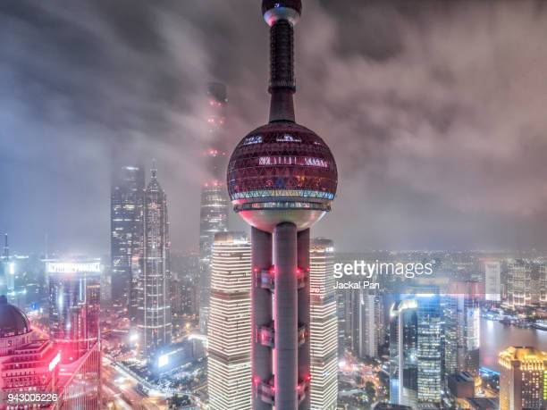 international landmark shanghai oriental pearl at night - international landmark stock pictures, royalty-free photos & images