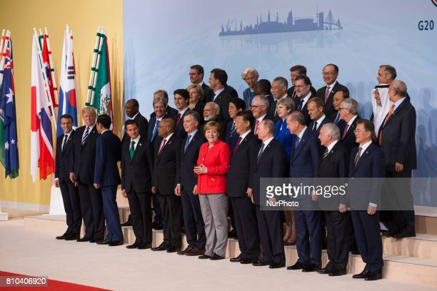 International leaders attend the group photo on the first day of the G20 economic summit on July 7 2017 in Hamburg Germany The G20 group of nations...