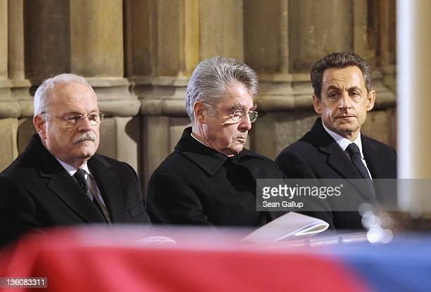International leaders, including Slovak President Ivan Gasparovic, Austrian President Heinz Fischer and French President Nicolas Sarkozy look on as...
