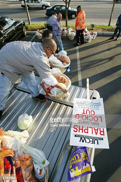 International Longshore and Warehouse Union member security guard Raymond Ramirez delivers Thanksgiving baskets to striking members of the United...