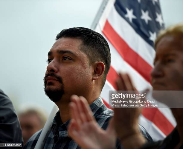 International Longshore and Warehouse Union members listen as ILWU President Ray Familia speaks at the rally, and march to the L.A. Harbor Commission...