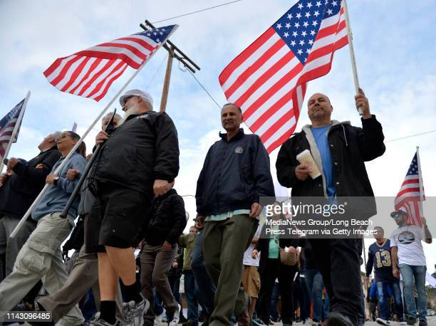International Longshore and Warehouse Union members march to the LA Harbor Commission Meeting in San Pedro on Tuesday April 16 2019 The union members...