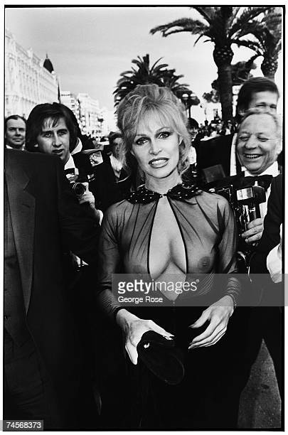 International lowbudget film star Bobbie Bresee arrives at the 1980 Cannes Film Festival in Cannes France in a seethrough blouse