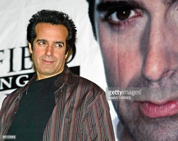 International magician David Copperfield poses for photographers prior a press conference in Mexico City 24 February 2004 Copperfield will perform in...