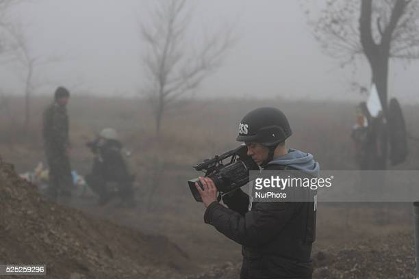 International media journalists work at a frontline where Ukrainian soldiers hold their positions on the edge of the so called quotsecurity zonequot...