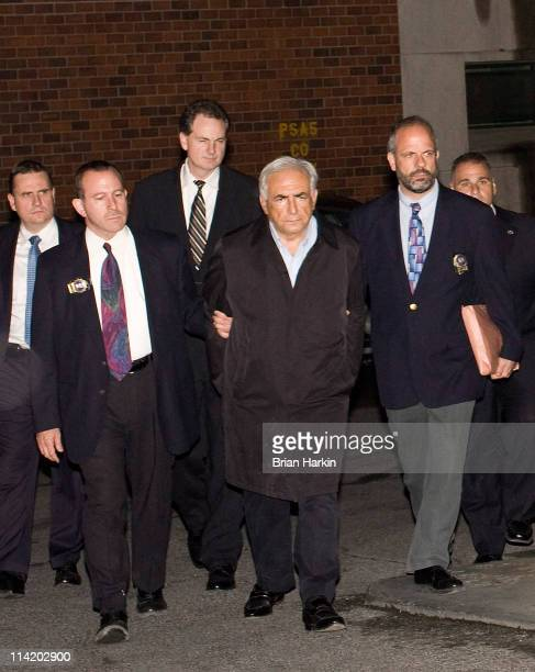 International Monetary Fund chief Dominique StraussKahn in handcuffs is walked to a police vehicle outside of a New York City Police Department...