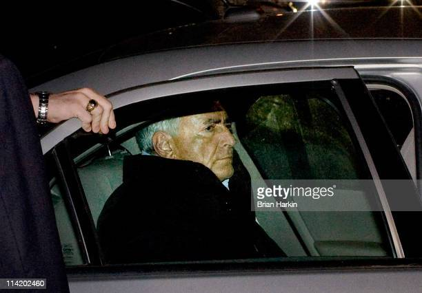 International Monetary Fund chief Dominique StraussKahn is placed in the backseat of a police vehicle outside of a New York City Police Department...