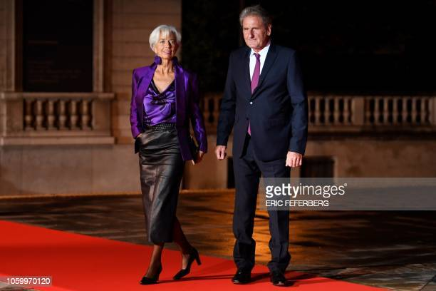 International Monetary Fund Christine Lagarde and President of property group Resiliance Xavier Giocanti pose as they arrive at the Musee d'Orsay in...