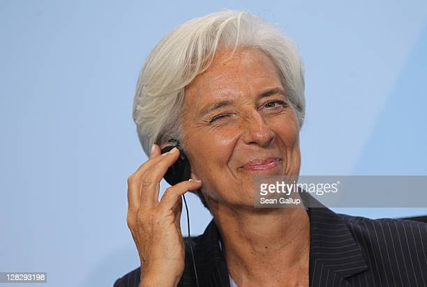International Monetary Fund Director Christine Lagarde winks while talking to the media following talks among world finance leaders at the...