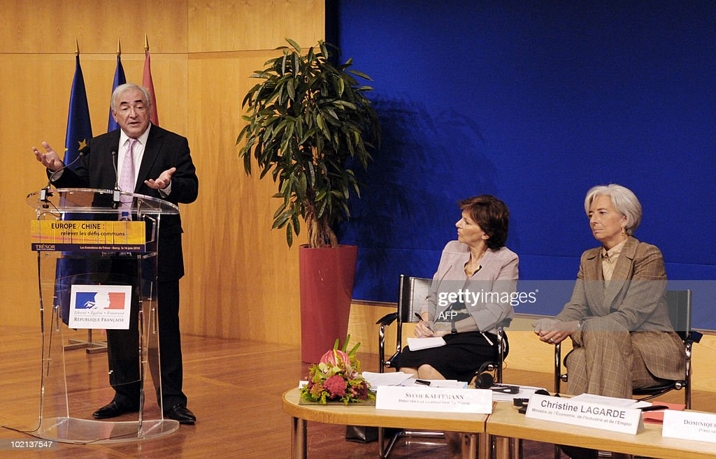 International Monetary Fund (IMF) head Dominique Strauss-Kahn (L) flanked by Sylvie Kauffmann, Le Monde's Executive Editor (C) and symposium moderator, and by French Economy minister Christine Lagarde (R) gestures as he gives a speech on June 16, 2010 in Paris at the symposium 'Europe/China: Facing our common challenges' organised in Paris by the French directorate-general of the Treasury.