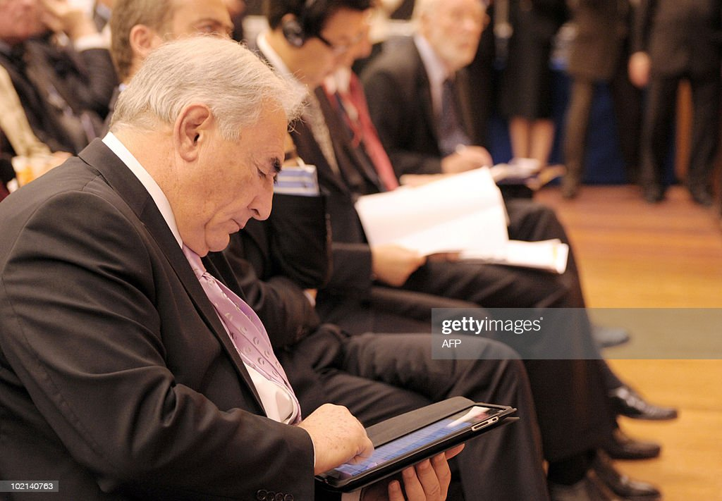 International Monetary Fund (IMF) head Dominique Strauss-Kahn reads on an electronic tablet on June 16, 2010 in Paris at the symposium 'Europe/China: Facing our common challenges' organised in Paris by the French directorate-general of the Treasury.