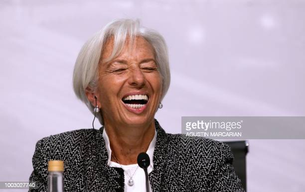 International Monetary Fund Managing Director Christine Lagarde laughs during a joint press conference with Argentina's Economy Minister Nicolas...