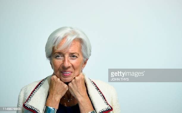 International Monetary Fund managing Director Christine Lagarde smiles during a press conference during an Eurogroup meeting at the EU headquarters...