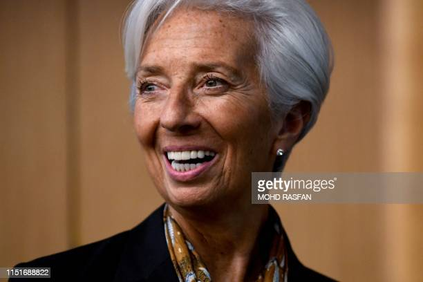 International Monetary Fund Managing Director Christine Lagarde smiles during a press conference in Kuala Lumpur on June 24 2019