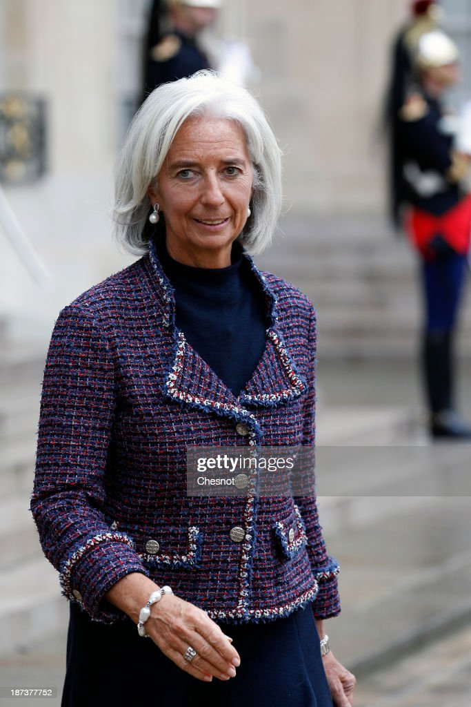 International Monetary Fund (IMF) Managing Director Christine Lagarde leaves after a meeting with French President Francois Hollande and leaders of the world organizations linked to G20 at the Elysee presidential Palace on November 8, 2013 in Paris. The rating of France's sovereign debt has been downgraded for the second time in two years, as ratings agency Standard and Poor's cut the nation's credit rating from AA+ to AA.