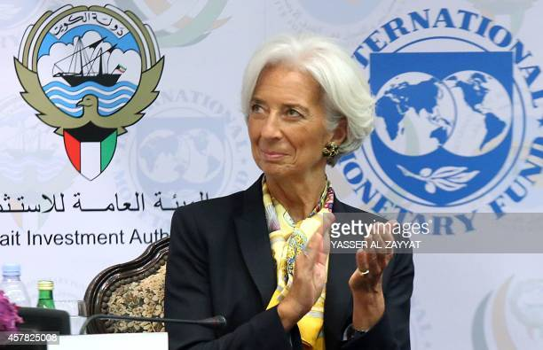 International Monetary Fund Managing Director Christine Lagarde applauds during a ceremony to inaugurate the Middle East Center for Economics and...