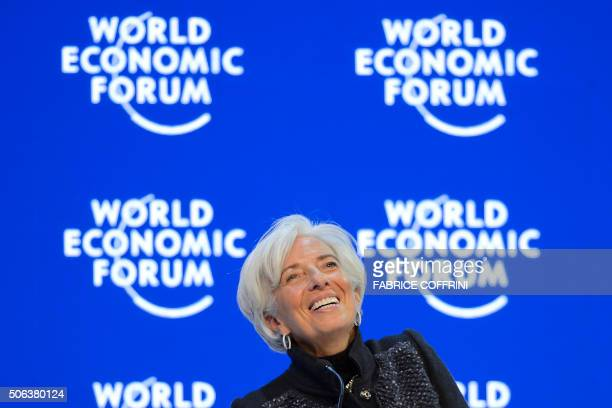 TOPSHOT International Monetary Fund Managing Director Christine Lagarde smiles during a session of the World Economic Forum annual meeting on January...