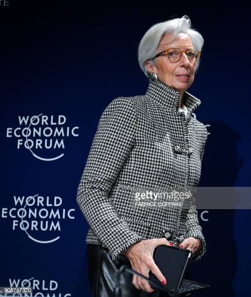 International Monetary Fund Managing Director Christine Lagarde leaves a press conference on IMF World Economic Outlook ahead of the World Economic...