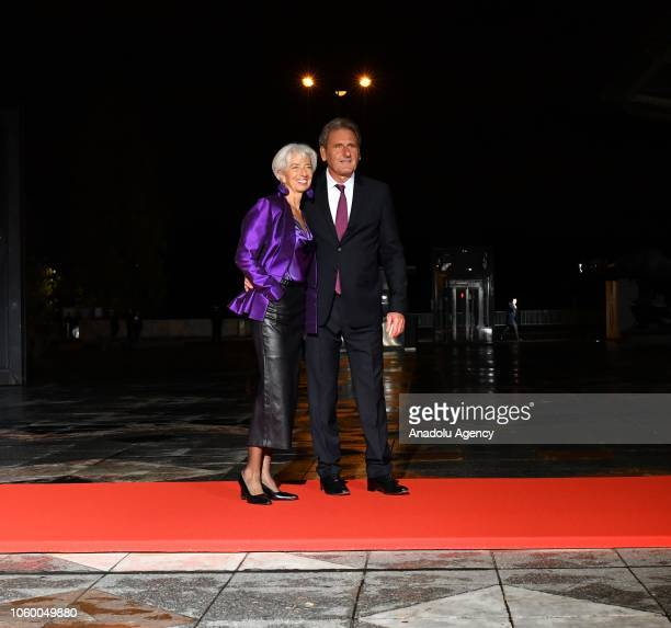 International Monetary Fund Managing Director Christine Lagarde and her partner Xavier Giocanti arrive at the official dinner on the eve of the...