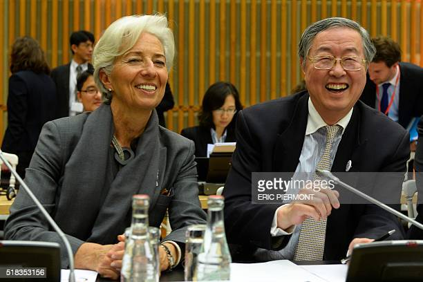 International Monetary Fund Managing Director Christine Lagarde and China's central bank governor Zhou Xiaochuan attend an allday highlevel seminar...