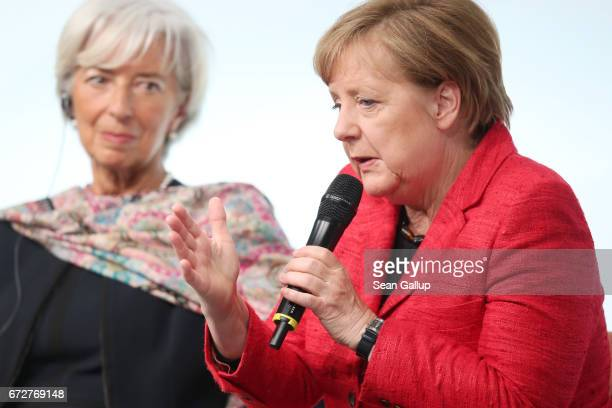 International Monetary Fund Managing Director Christine Lagarde and German Chancellor Angela Merkel talk on stage at the W20 conference on April 25...