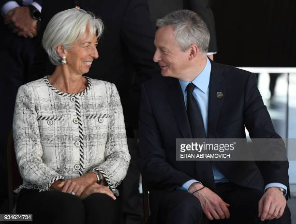 International Monetary Fund Managing Director Christine Lagarde and French Economy Minister Bruno Le Maire chat as they sit for the family picture of...