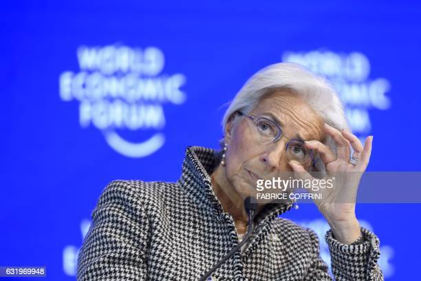 International Monetary Fund managing director Christine Lagarde adjusts her glasses as she attends a session on the second day of the World Economic...
