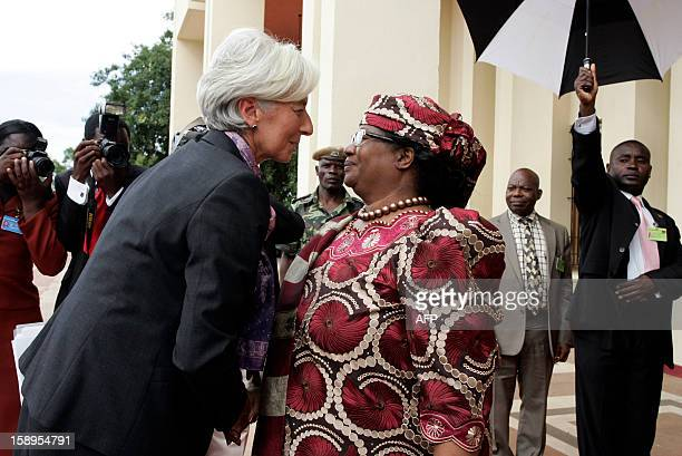 International Monetary Fund Managing Director Christine Lagarde is greeted by Malawi's President Joyce Banda on arrival at Kamuzu Palace in Lilongwe...