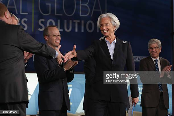 International Monetary Fund Managing Director Christine Lagarde is welcomed to the stage before delivering opening remarks during a panel about...