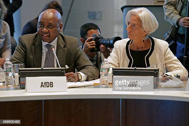 International Monetary Fund Managing Director Christine Lagarde looks on as African Development Bank Group President Donald Kaberuka delivers remarks...