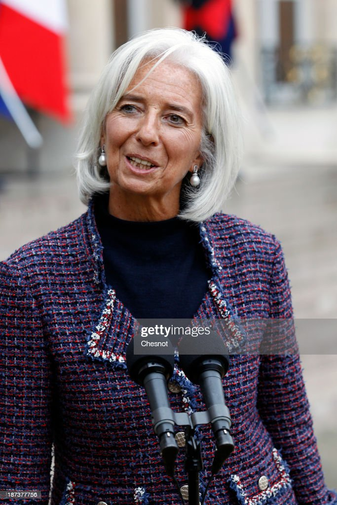 International Monetary Fund (IMF) Managing Director Christine Lagarde makes a statement after a meeting with French President Francois Hollande and leaders of the world organizations linked to G20 at the Elysee presidential Palace on November 8, 2013 in Paris. The rating of France's sovereign debt has been downgraded for the second time in two years, as ratings agency Standard and Poor's cut the nation's credit rating from AA+ to AA.