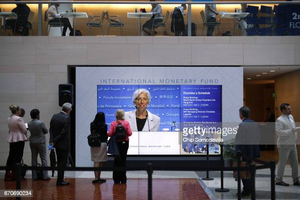 International Monetary Fund Managing Director Christine Lagarde appears on a video wall during a news conference at the World Bank and IMF Spring...
