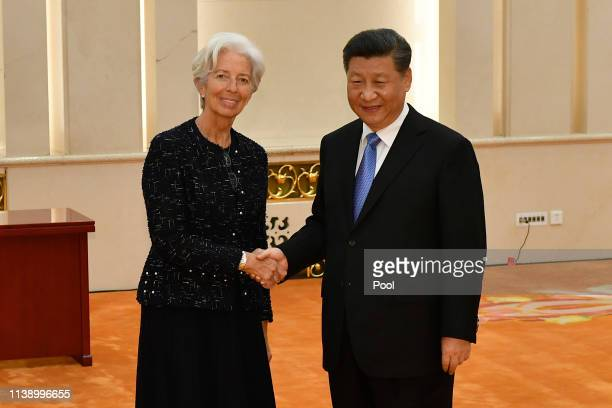 International Monetary Fund Managing Director Christine Lagarde shakes hands with Chinese president Xi Jinping before their meeting at the Great Hall...