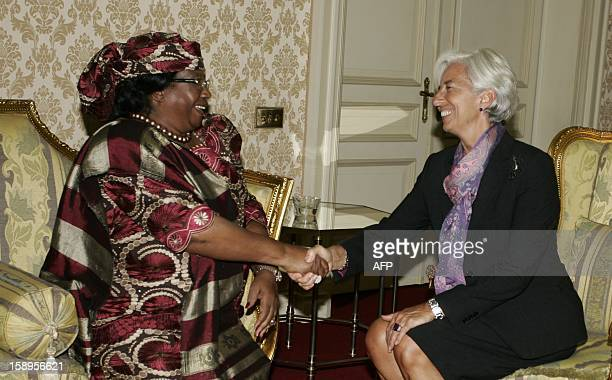 International Monetary Fund Managing Director Christine Lagarde shakes hands with Malawi's president Joyce Banda prior to a meeting at Kamuzu Palace...