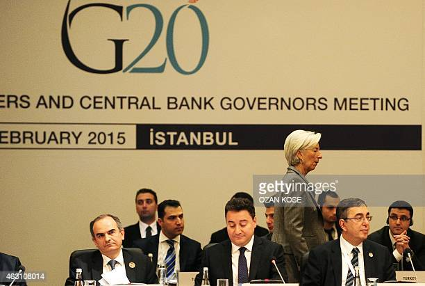 International Monetary Fund Managing Director Christine Lagarde passes behind Turkish Deputy Prime Minister Ali Babacan during the G20 finance...