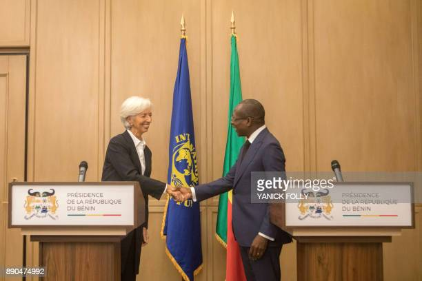 International Monetary Fund Managing Director Christine Lagarde shakes hands with Benin President Patrice Talon during a joint press conference in...
