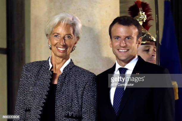 International Monetary Fund managing director Christine Lagarde poses with French President Emmanuel Macron during their meeting at the Elysee Palace...