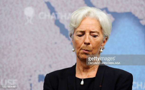International Monetary Fund Managing Director Christine Lagarde listens to British Chancellor of the Exchequer George Osborne during a debate on...