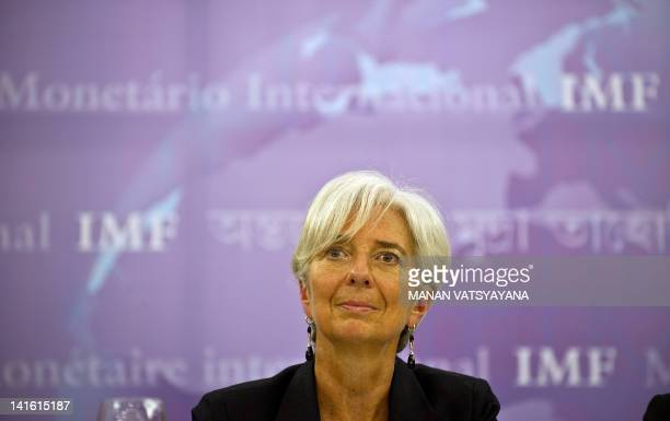 International Monetary Fund managing director Christine Lagarde listens to questions from media representatives during a press conference in New...