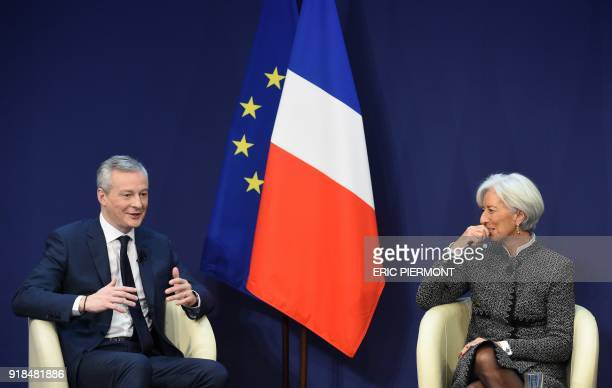 International Monetary Fund Managing Director Christine Lagarde listens to French Economy and Finance Minister Bruno Le Maire as they attend a...