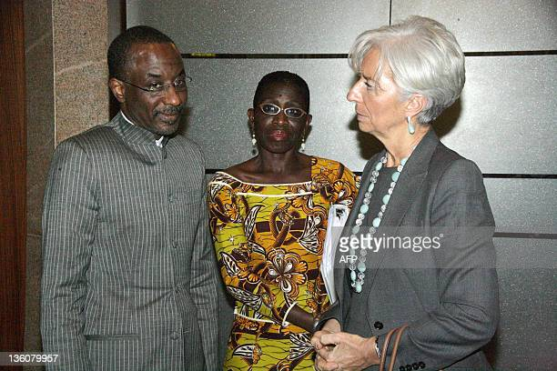 International Monetary Fund Managing Director Christine Lagarde speaks with Nigerian Central Bank Governor Lamido Sanusi Lamido and the director...