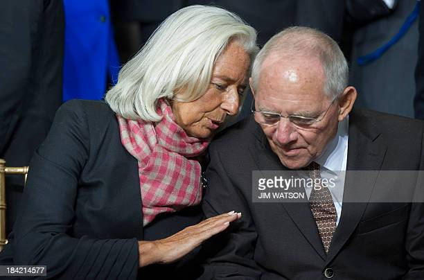 International Monetary Fund Managing Director Christine Lagarde speaks with German Finance Minister Wolfgang Schaeuble during the family photo...
