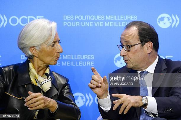 International Monetary Fund Managing Director Christine Lagarde speaks with French President Francois Hollande during an OECD meeting in Paris on...