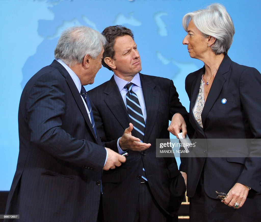 International Monetary Fund Managing Director Dominique Strauss-Kahn chats with US Treasury Secretary Tim Geithner and France's Finance Minister Christine Lagarde after G-20 Finance Ministers and Central Bank Governors posed for a group photo following their meeting at the IMF/World Bank Spring Meetings April 23, 2010 at IMF Headquarters in Washington, DC. AFP PHOTO/Mandel NGAN