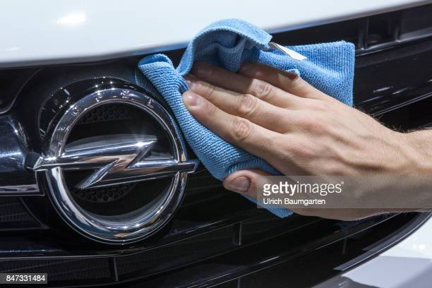 International Motor Show 2017 in Frankfurt Hand with a cloths cleans the Opel logo